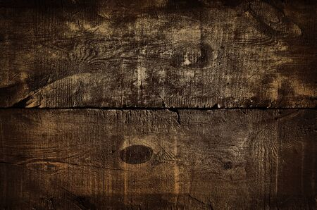 Dark rustic golden wall background, texture of old gilded top table. Wood grunge texture, top view of brown golden wooden table. Vintage background with gold particles. For montages display of product Stock fotó