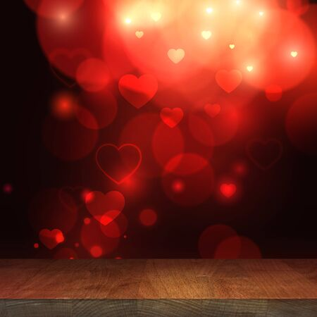 Valentines day. Wooden stage top table with blurred heart bokeh background, empty wooden table with a festive background