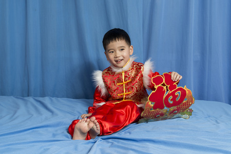 blessing: Child holding the Chinese new year blessing decoration