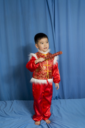 national fruit of china: children holding a candied  gourd Stock Photo