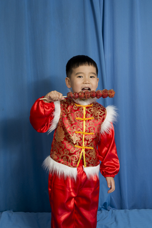 national fruit of china: children holding a candied gourd