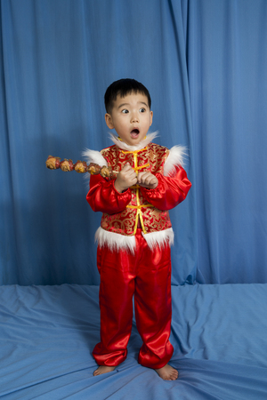national fruit of china: Festival of children holding a gourd