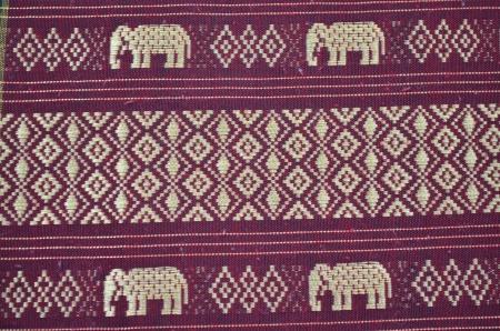 Thai silk pattern hand made with elephants photo