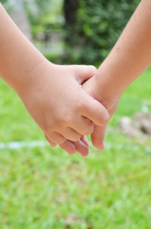 Little sibling hand holding photo