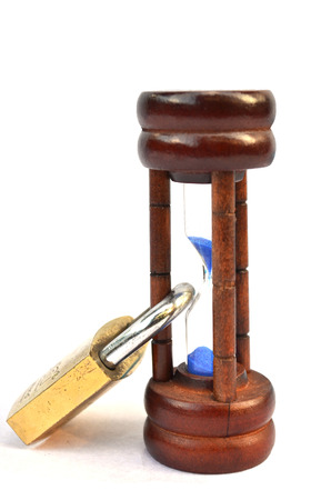 constraint: Time lock on hourglass on white background Stock Photo