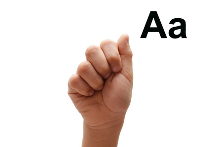 fingerspelling: A kid hand spelling american sign language ASL Stock Photo