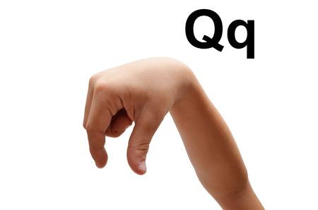 fingerspelling: Q kid hand spelling american sign language ASL