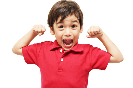 strong boy: Little boy showing his muscles on white background