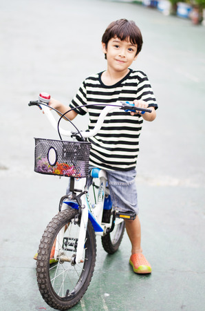 Little boy riding a bicycle photo