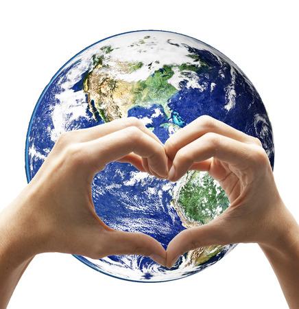 Love hand make heart shape on earth  photo