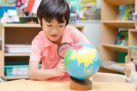 Little boy learning map  photo