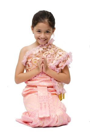 Little girl on Thai costume on white background Stock Photo