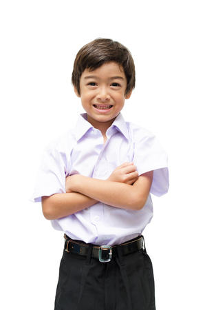 Little student boy in uniformon white background photo