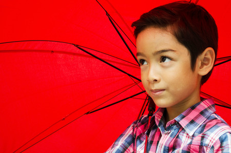 Little boy taking an umbrella photo