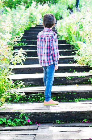 Little boy walking on Stairs going uphill photo