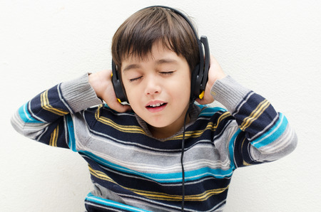 Little boy listening the music with headset photo