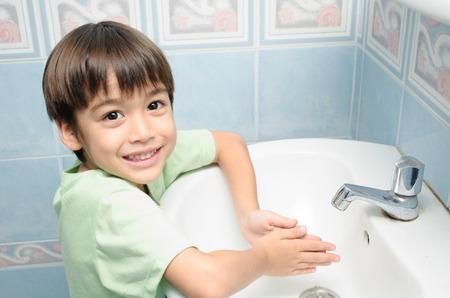 child bath: Little boy waiting for washing hand