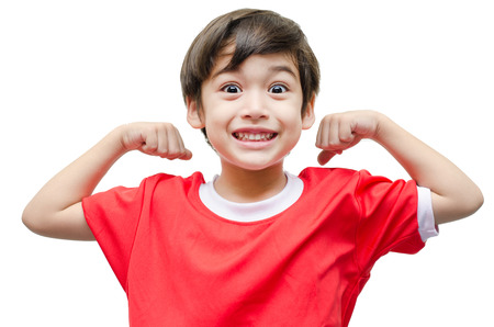 an athlete: Little boy showing his muscles on white background Stock Photo