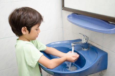 Little boy washing hand Stock Photo