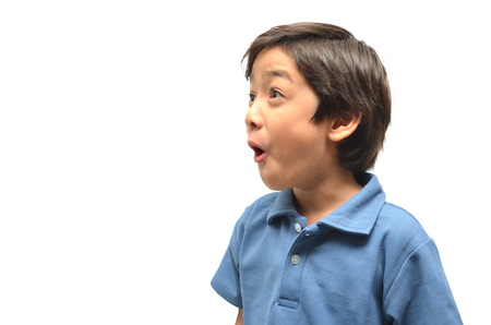 little boy open mouth wide surprise face on white background