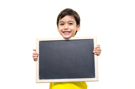 Little boy holding a blackboard over white background