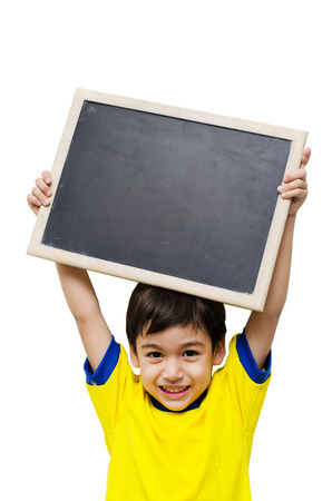 Little boy holding a blackboard over white background Reklamní fotografie - 32603590