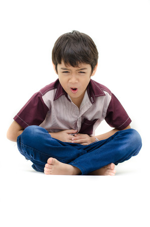 Little boy has stomach ache on white background photo