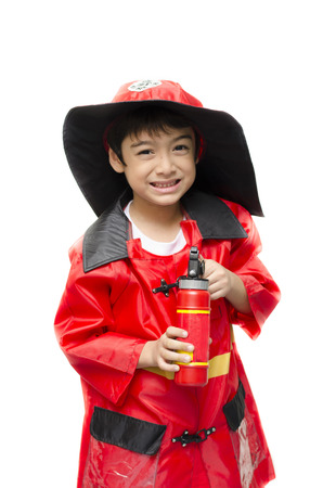 pretend: Little boy pretend as a fire fighter on white background Stock Photo