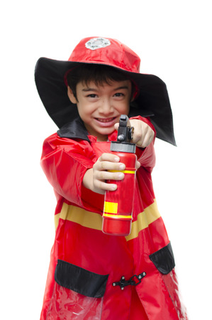 fireman: Little boy pretend as a fire fighter on white background Stock Photo
