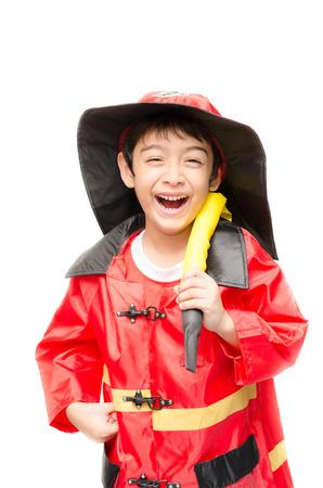 Little boy pretend as a fire fighter on white background Standard-Bild