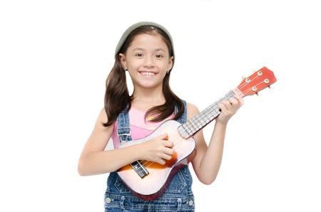 Little girl playing ukulele on white background