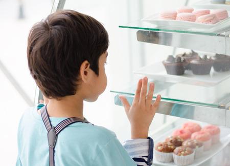 bakery store: Little boy at the bakery shop