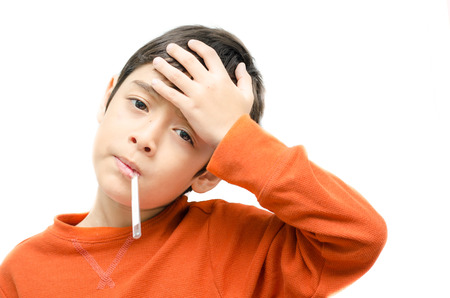Little sick boy with temperature in mouth on white background