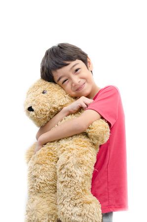 teddy bear love: Little boy hold teddy bear on white background