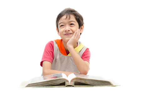 children school: Little boy reading a book and think on white background