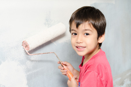 Littleboy painting wall white color at home photo