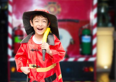 Little boy pretend as a fire fighter