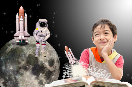 take a history: Little boy dreaming  about his future out of space