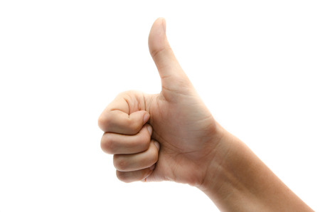thumps up: Woman hand thumps up on white background Stock Photo