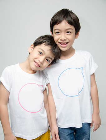 Little sibling boy in white shirt together