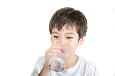 little asian boy drinks water from a glass Reklamní fotografie