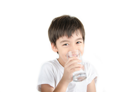 little asian boy drinks water from a glass Banque d'images