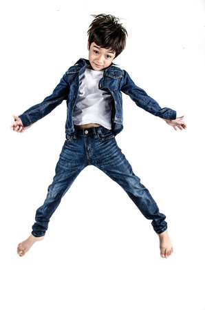 Little boy in jean cloth fashion jumping isolate on white background clarity filter light photo