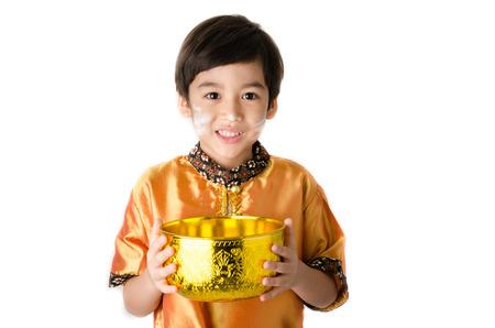 thai boy: Thai boy splashing water by using hand  from bowl