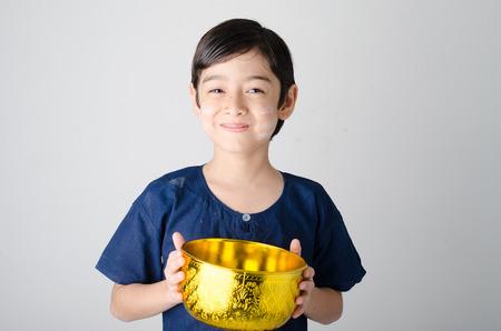 thai boy: Thai boy hand holding bowl for water festival
