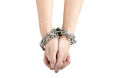 Woman hand was tied by chain isolate on white background photo