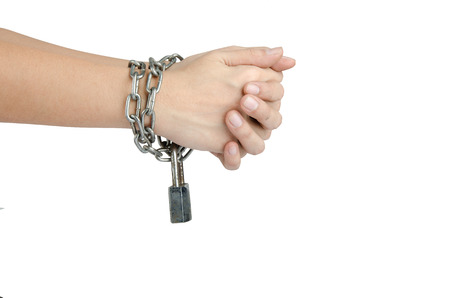Woman hand was tied by chain isolate on white background