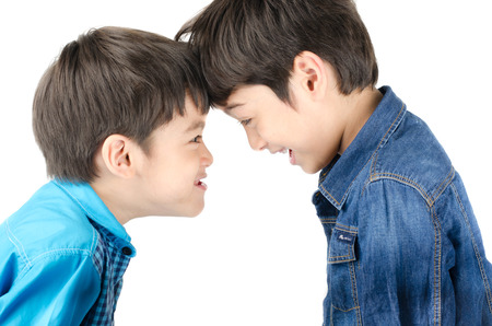 brother sister fight: Little sibling boy fighting on white background