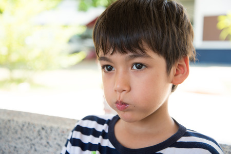 troubled teen: Little boy with sad face