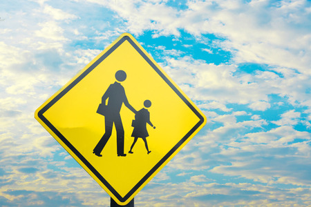 cross road: Sign close to school wait for kid cross the road with blue sky